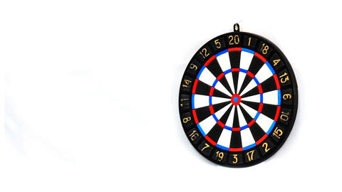 Darts stucks in a target Stock Video Footage