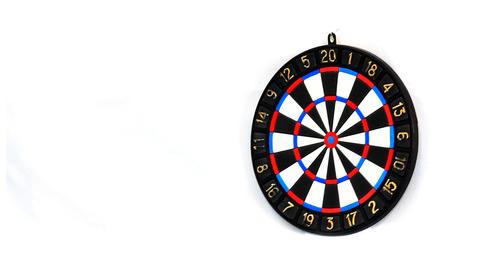 Darts stucks in a target Stock Video Footage