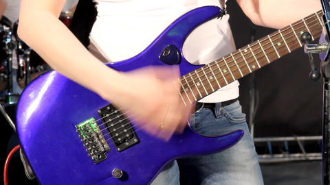 Close-up of female hand, playing the rhythm guitar Stock Video Footage