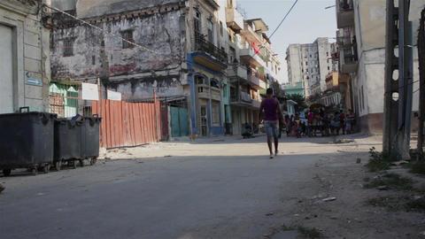 LA HAVANA, CUBA, CIRCA 2015: People and a taxi cyclist in La habana Vieja, in La Live Action