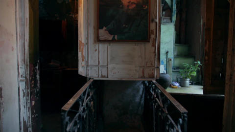 Old building interior with an vintage Fidel Castro picture and stairs Footage