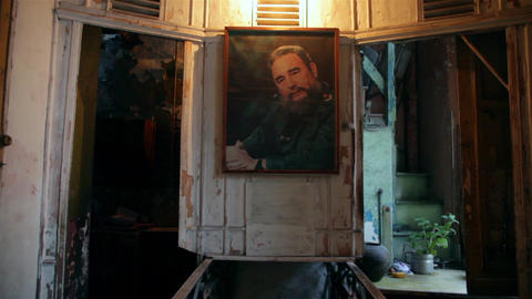 Old building interior with an vintage Fidel Castro... Stock Video Footage
