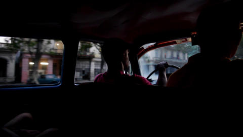 Taxi driver in La Habana Cuba with passengers Footage