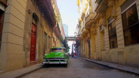 Green old car in La Habana Vieja streets in a Havana Cuba Footage