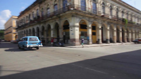 Two cuban vintage cars crossing the street in La Habana, Cuba Footage