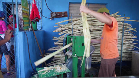 Boy Making Guarapo Cubano With Sugar Cane stock footage