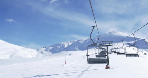 Empty Ski lift with skiers in the background 4K Footage