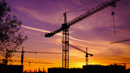Time lapse cranes working in construction site at dusk, static shot Footage