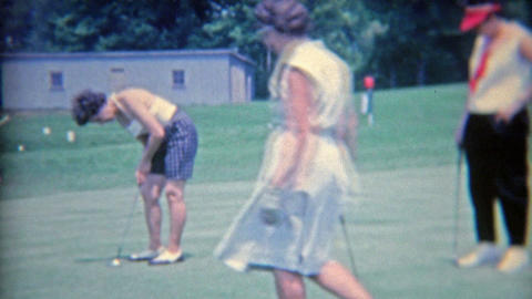 1964: Women putting on the golf green as the ladies enjoy the day out Footage