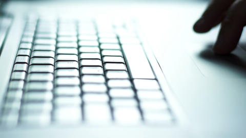Silhouette of man's hands typing on keyboard against the light Footage