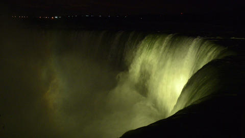 Iluminated Niagara Falls And The Mist In The Night stock footage