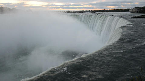 The falling water of Niagara Falls in the early morning pulls into the depth Footage