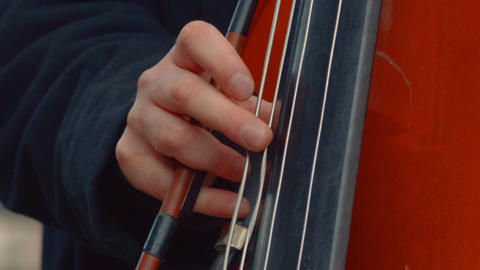 Cello Musician Playing in the Street Close-up Footage