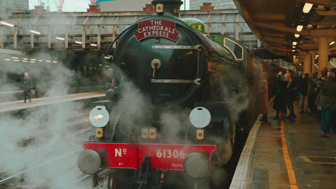 Passengers Boarding a Steam Train at Victoria Station in London Footage