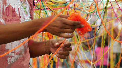 Children Enjoying with Skeins of Multicolored Wool Footage