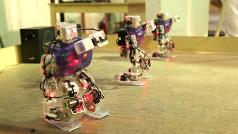 The dance of three robots Live Action