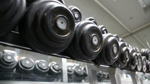 Sports dumbbells laid out in a row 圖片