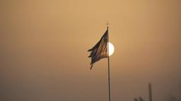 Greek flag against the evening sun Footage