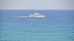 A fancy deep seas yacht passing by Footage