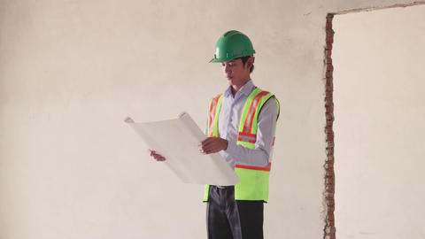 15of 23 manual worker , engineer and architect in construction site Footage