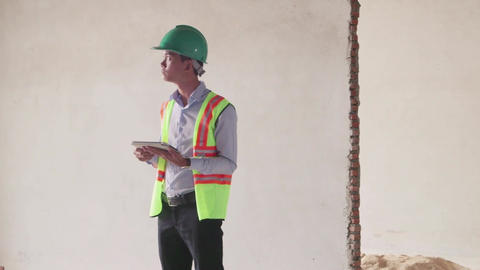 16of 23 manual worker , engineer and architect in construction site Footage