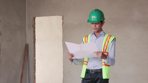 9of 23 manual worker , engineer and architect in construction site Footage