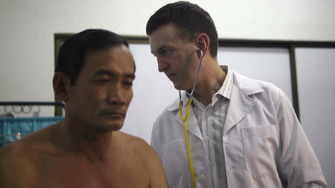 Asian Patient During Visit With Doctor In Hospital Clinic stock footage