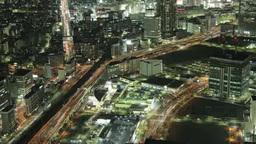 照明を点けた横浜のビル群と高速を行き交う車郡を俯瞰す Footage