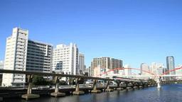 都会の運河沿いを走る東京モノレール Footage