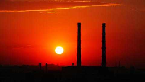 Time Lapse Sunset And Industrial Zone Silhouette stock footage