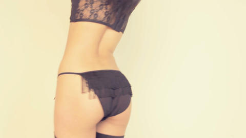 female wearing black lingerie and belly ring Stock Video Footage