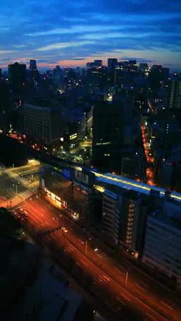 水道橋交差点と丸の内方向のビル群とJR水道橋駅 黎明の夜 Footage