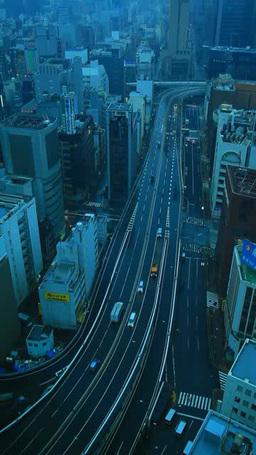 雨の朝の銀座と新橋のビル群と東京高速道路 Footage