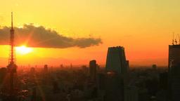 夕日の光芒と東京タワーと富士山と汐留などのビル群 Footage