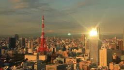 東京タワーと富士山と朝日に輝く汐留などのビル群 Footage