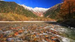 Fresh snow, Hodaka mountain range in autumn, and Azusa river Footage