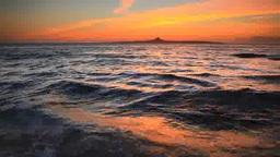 伊江島と夕焼けとビーチに打ち寄せる波 Footage