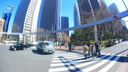 新宿の高層ビル群と横断歩道を渡るサラリーマンとOL Footage
