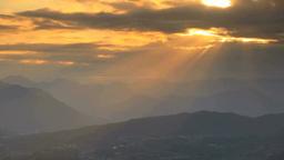 祢津城跡から望む尾野山城跡方向の山並みと夕日の光芒 Footage