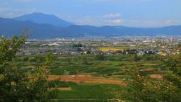 妻女山展望台から望む川中島古戦場と飯縄山の夕景 Footage
