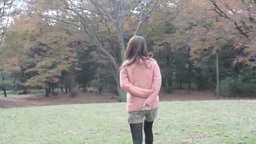 Young woman walking through a park Footage