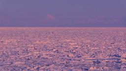 オホーツク海の流氷と知床連山の夕景 Footage