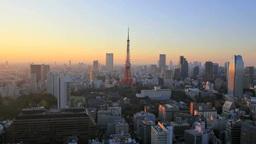 東京タワーの夕景色と夕焼け空とビル群 Footage
