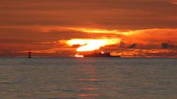 小笠原父島の扇浦の夕焼けと洛陽を通過する船 Footage