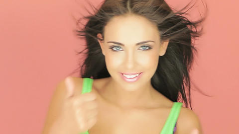 Beautiful brunette giving a thumbs up Stock Video Footage