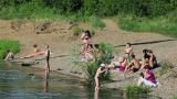 People sunbathe on the beach of Siberian river Footage