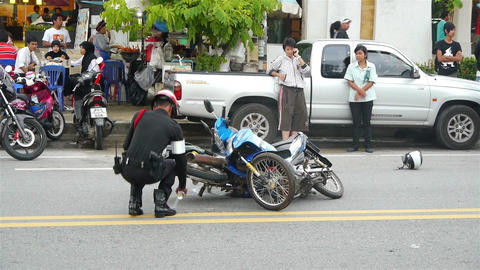Policeman at the scene of motorbikes crash Stock Video Footage