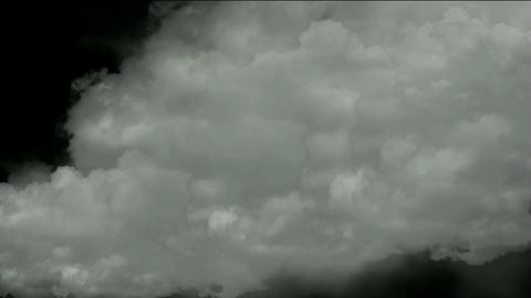 rolling clouds & flying smoke Stock Video Footage