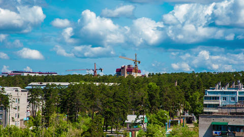 City, forest and tower cranes HDR timelapse Stock Video Footage