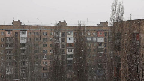 Winter. Snow falls on the background of houses Stock Video Footage
